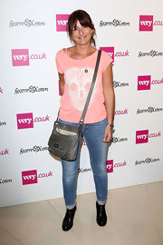 Davina McCall was casual and edgy at the Very.co.uk collection launch in a skull-print shirt, jeans, boots, and a leather shoulder bag.