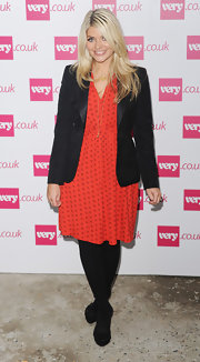 A classic black blazer added a modern touch to Holly Willoughby's retro-style feminine frock.