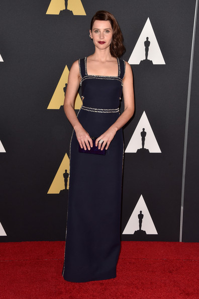 Felicity Jones Box Clutch [flooring,carpet,fashion model,shoulder,red carpet,dress,fashion,little black dress,gown,cocktail dress,felicity jones,hollywood highland center,california,the ray dolby ballroom,academy of motion picture arts and sciences,governors awards]