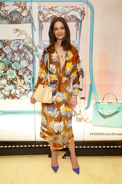 Katie Holmes completed her ensemble with a champagne leather shoulder bag by Fendi.