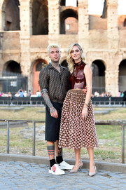 Chiara Ferragni looked darling in a Fendi Couture dress with a fitted, sequined bodice and a floral-embroidered skirt during the brand's Fall 2019 show.