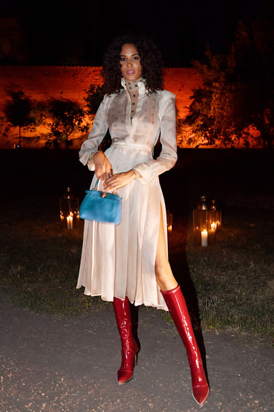 Cindy Bruna added an extra pop of color with a blue leather purse.