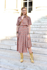 Chiara Ferragni went for cool styling with a pair of gold cowboy boots by Fendi.