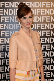 Louise Bourgoin showed her playful side with a fitted jacket with blue trim while at the Fendi runway show in Milan.