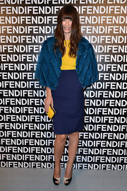 Caroline De Maigret popped with color at the Fendi runway show with a navy pencil skirt and yellow top.