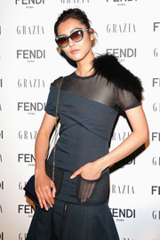Liu Wen arrived for the Fendi party wearing a pair of green-rimmed sunglasses.