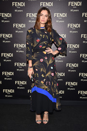 Kasia Smutniak attended the Fendi Roma 90th anniversary cocktail wearing a printed maxi dress from the label.