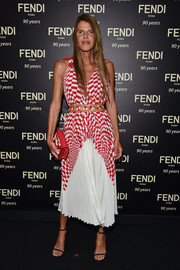 Anna dello Russo was breezy and stylish in a pleated checkered dress by Fendi during the brand's 90th anniversary cocktail.