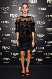 Chiara Ferragni went for whimsical elegance in a black Fendi fur dress with an embroidered yoke during the label's 90th anniversary cocktail.