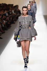 Bella Hadid looked cute on the Fendi runway wearing this striped mini dress that came with a matching apron.