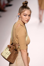 Gigi Hadid carried a stylish suede and leather cross-body bag at the Fendi Spring 2019 show.