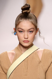 Gigi Hadid rocked a towering top knot at the Fendi Spring 2019 show.