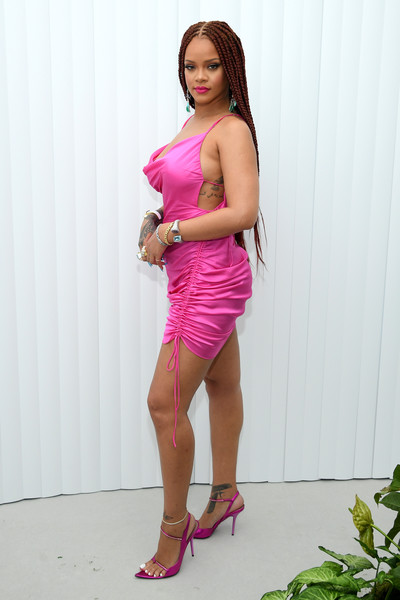 Rihanna matched her dress with strappy pink heels.