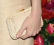 Amanda Hearst chose this straw-print hard case clutch to pair with her nude frock for a cool and summery look.