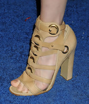 Amanda Hearst chose this pair of light tan gladiator heels for her look at the Ferragamo launch of L'Icona Highlighting.