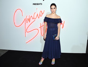 Alaia Baldwin went for boho charm in a navy off-the-shoulder dress by Ferragamo during the brand's Gancio Studios, Celebrating 100 Years in Hollywood event.