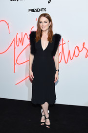 Julianne Moore made a chic appearance at the Ferragamo Presents: Gancio Studios, Celebrating 100 Years in Hollywood event wearing this plunging, fur-trimmed LBD from the brand.