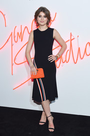 Sami Gayle attended the Ferragamo Presents: Gancio Studios, Celebrating 100 Years in Hollywood event wearing a black knit dress accented with multicolored diagonal stripes down the skirt.