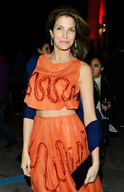 Stephanie Seymour stood out in an embellished orange crop-top with a matching skirt during an event honoring Ferrari chairman Luca di Montezemolo.