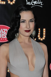Dita Von Teese wore a rich deep burgundy lipstick while attending the premiere of 'Feu.'