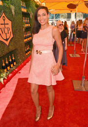 Rosario Dawson gave a girly touch to the 5th Annual Veuve Clicquot Polo Classic in a printed day dress by Shoshanna.