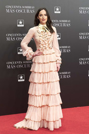 Dakota Johnson attended the Madrid premiere of 'Fifty Shades Darker' wearing an explosion of baby-pink ruffles!