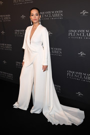 Rita Ora was diva-glam in a draped white Stephane Rolland Couture jumpsuit with a flowing cape at the Paris premiere of 'Fifty Shades Freed.'