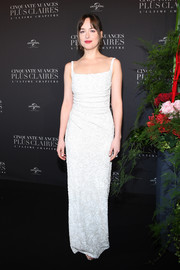 Dakota Johnson went for understated elegance in a white sequin column dress by Prada at the Paris premiere of 'Fifty Shades Freed.'