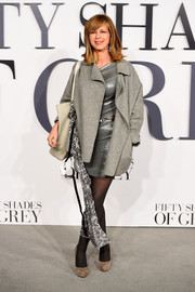 Kate Garraway layered a bulky gray wool coat over a silver mini for the 'Fifty Shades of Grey' UK premiere.
