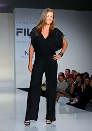 A sleek black jumpsuit gives Agnieszka a legs-for-miles look on the runway.