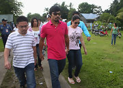 Manny Pacquiao visited a school wearing a casual red Abercrombie and Fitch polo shirt.