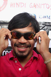 Manny donned sporty orange reflective shades along with a big smile.