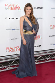 Jessica showed off her petite figure in this slashed sheer gown with a striking gold waist band.
