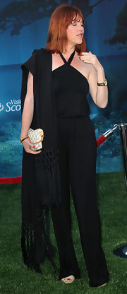 Molly Ringwald looked daring yet chic in her black halter jumpsuit and fringed shawl.
