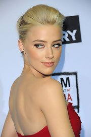 Amber Heard wore a soft peachy-pink lipstick to the premiere of 'The Rum Diary.' The pale, satin finish lip look was perfectly paired with her red dress and fluttery lashes.