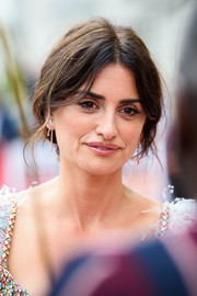 Penelope Cruz styled her hair into a romantic loose bun for the UK premiere of 'Pain and Glory.'