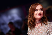 Isabelle Huppert wore her hair down to her shoulders in a wavy style at the 2019 Venice Film Festival.