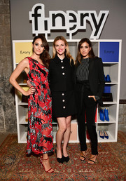 Emmy Rossum looked vibrant in a one-shoulder print dress by Carolina Herrera at the Finery App launch.
