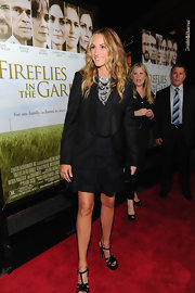 Julia Roberts looked flawless on the red carpet in a black tuxedo-inspired blazer and sparkling statement necklace.
