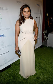 Mindy looked serenely elegant in this nude gown with an hourglass silhouette at the Baby2Baby Gala in Culver City.