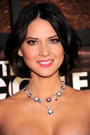 Olivia Munn paired her elegant look with a multi-colored gemstone necklace.