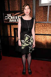 Kristen Schaal teamed her black print dress with black suede mary jane style flats.
