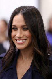 Meghan Markle attended the Royal Foundation Forum wearing her hair down with a center part and a slight wave.