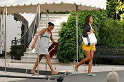 Sasha Obama was one cool traveler in a black-and-white striped sundress.