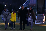 Michelle Obama cozied up in a patterned gray wool coat as she arrived with her family from a Hawaiian vacation.
