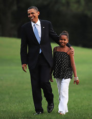 Sasha Obama looked cool and laid-back in her summer ensemble, consisting of a breezy floral top and white eyelet pants.