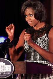 Michelle Obama wore a busy-looking ensemble to a White House dance workshop, consisting of a part-leopard, part-lace print dress and an oversized cutout belt.