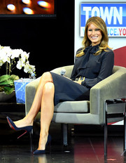 Melania Trump kept it business-like in a navy tie-neck dress by Max Mara for a Las Vegas Town Hall meeting.