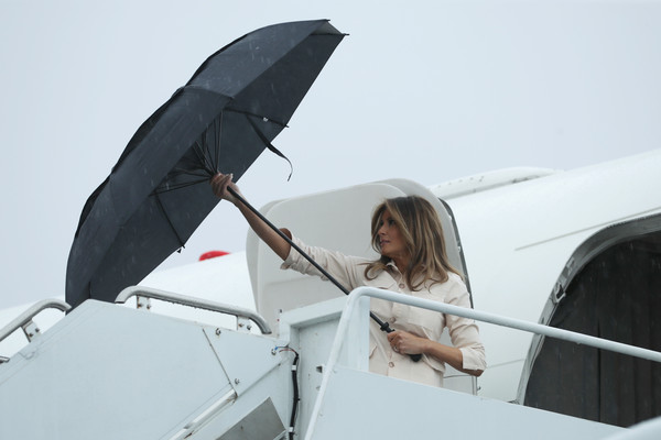 Melania Trump arrived at McAllen Miller International Airport in Texas on a rainy day to attend a roundtable discussion. She geared up for the wet weather with a large black umbrella.