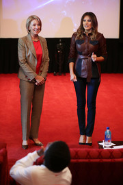 Melania Trump kept it casual yet chic in a burgundy and navy leather jacket by Victoria, Victoria Beckham at a screening of 'Wonder' in the White House movie theater.